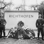 Two Nazi soldiers stand guard at the grave of Manfred Freiherr von Richthofen, the most successful German fighter pilot during WWI with 80 downed planes, in Berlin, Germany, April 5, 1938.