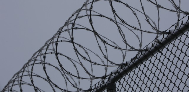 Razor wire lines a walkway at an Illinois prison