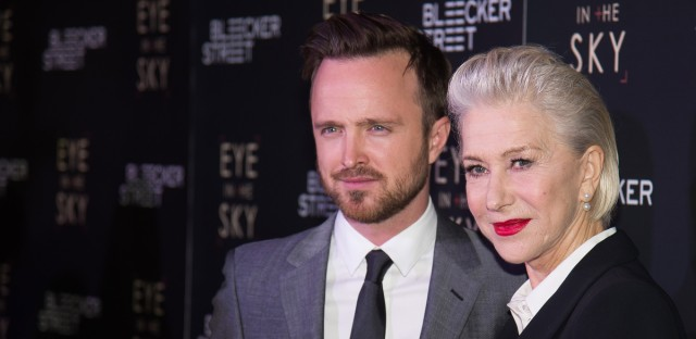 """Aaron Paul, left, and Helen Mirren attend the premiere of """"Eye In The Sky"""" at AMC Loews Lincoln Square on Wednesday, March 9, 2016, in New York. (Photo by Charles Sykes/Invision/AP)"""