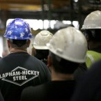 Employees at the Lapham-Hickey Steel plant listen to Republican gubernatorial candidate Bruce Rauner during Rauner's tour of the facility Monday, Oct. 27, 2014, in Chicago.