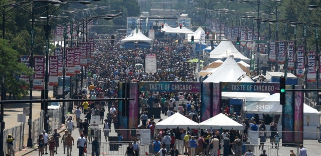 People fill Columbus Ave. while attending the Taste of Chicago to browse local food in Chicago's Grant Park on July 6, 2017. The list of vendors for this year's food festival was released Thursday.