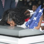 Myeshia Johnson kisses the casket of her husband, Army Sgt. La David Johnson, during his burial service on Saturday in Hollywood, Florida. Sgt. Johnson and three other U.S. soldiers were killed in an ambush in Niger on October 4.