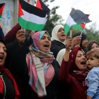 Women wave Palestinian flags and chant slogans during a protest at the Unknown Soldier Square, in Gaza City, Wednesday, Dec. 6, 2017.
