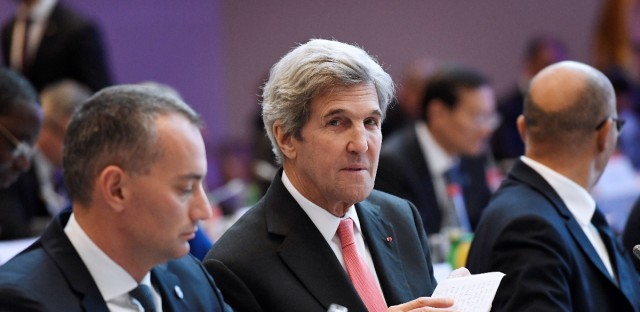 U.S. Secretary of State John Kerry attends the peace conference in Paris on Sunday. Foreign ministers and representatives from about 70 countries are seeking to revive the moribund Israeli-Palestinian peace process.