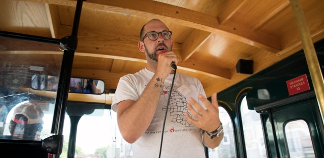 James Rudyk, executive director of the Northwest Side Housing Center, speaks during a trolley tour of neighborhood projects on Chicago's Northwest Side.