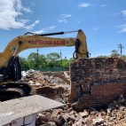On July 18, a bulldozer clears what is left of the strip of storefronts on 58th Street that housed Assata's Daughters.