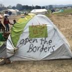Graffiti on tents at the makeshift migrant camp in Idomeni, Greece.