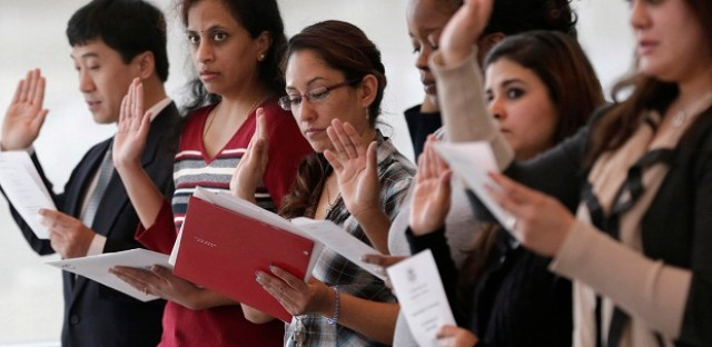 Immigrants take the U.S. oath of citizenship during a Jan. 28 naturalization ceremony in Irving, Texas.