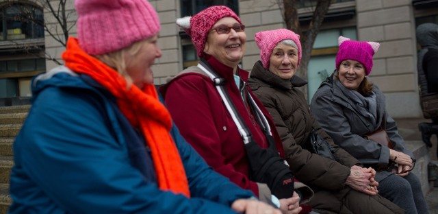 (Left to right) Melissa Breen, Laura Jamison, Sandy Cuza and Kathryn Wehrmann chat while sporting matching pink hats in support of the march.