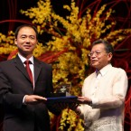 Ma Jun of China, left, a 2009 Ramon Magsaysay awardee, Asia's equivalent of the Nobel Prize, receives his medallion and citation from Philippine Supreme Court Chief Justice Reynato Puno during an award ceremony Monday, Aug. 31, 2009 at the Cultural Center of the Philippines in Manila.