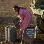 A Yezidi woman collects water for her sheep from a truck on Mount Sinjar, 250 miles (404 kilometers) northwest of Baghdad, Iraq, Monday, Sept. 19, 2005. One of Iraq's forgotten religious minorities, the Yezidis eke out lives in the shadow Mount Singer.