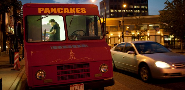 In this July 12, 2012 photo, Leah Wilcox packs up her Babycakes food truck after selling to customers in Chicago. An ordinance proposed by Chicago Mayor Rahm Emanuel would finally allow trucks to cook and prepare food on board. While the trucks are already allowed on Chicago's streets, current rules prohibit operators from so much as putting hot sauce on a taco for a customer. The proposal would continue to ban them from setting up shop any closer than 200 feet away from restaurants and capping the time they can stay put in one spot at two hours.