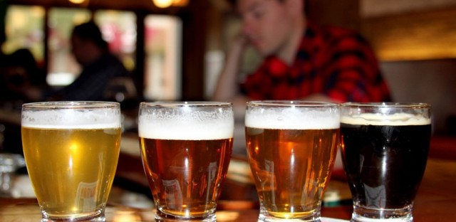 Taster portion of four beers made in-house at Revolution Brewing in Logan Square. Tricia Bobeda/WBEZ