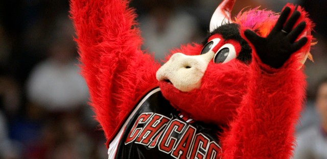 ** FILE ** Chicago Bulls mascot Benny the Bull dances during a time in this April 1, 2006 file photo in Chicago. Some days it just doesn't pay to get out of bed and strap on the old Bull head. Benny the Bull found that out the other day when he was busted for allegedly punching an off-duty officer.