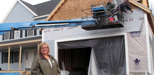 De Desharnais, a homebuilder and real estate agent in Nashua, N.H., stands in front of a house her company is constructing. She says her company had 32 employees at the height of the housing boom, and now only has six despite the industry's gradual recovery.