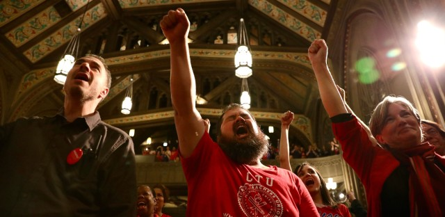 Members of the Chicago Teachers Union and SEIU Local 73 rally at First United Methodist Church at the Chicago Temple on Monday, October 14, 2019.
