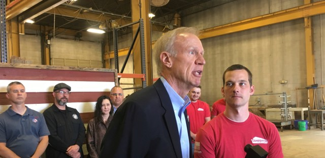 Gov. Bruce Rauner, center, speaks to reporters Tuesday, May 1, 2018, in Springfield about reconstructing the Quincy veterans' home because of lingering Legionnaires' disease.