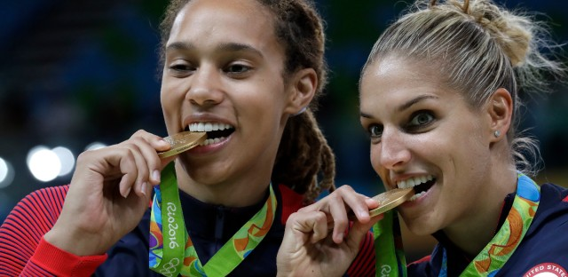 United States' Brittney Griner, left, and Elena Delle Donne, right, celebrate with their gold medals after their win in a women's basketball game against Spain at the 2016 Summer Olympics in Rio de Janeiro, Brazil, Saturday, Aug. 20, 2016.