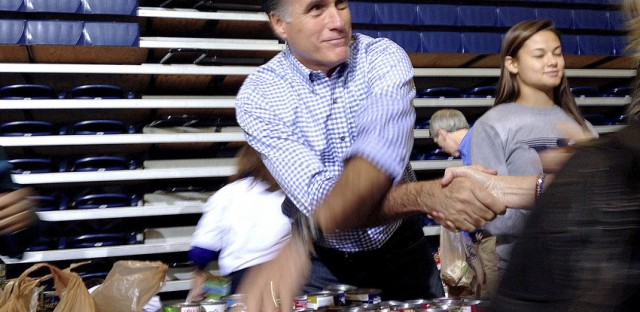 Republican presidential candidate Mitt Romney collects supplies for victims of superstorm Sandy at a campaign event in Kettering, Ohio, Tuesday.