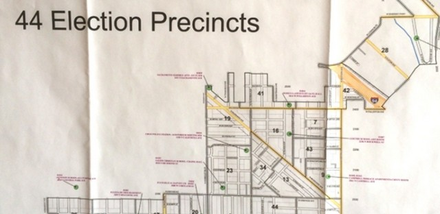 File: A map posted on the wall of a Chicago campaign office. Many campaigns use the same database to find likely voters, but the advocacy group Asian Americans Advancing Justice worries that inaccurate information diminishes minority voter blocs' appeal.