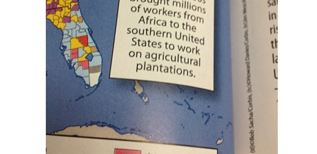 """High school freshman Coby Burren texted his mom this image of his world geography book that calls slaves """"workers."""""""