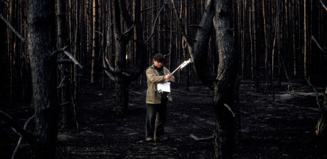 A technician checks a spot with a Geiger counter in a forest which burned in 1992. The wildfire released radioactive particles into the air that were first deposited there by the nuclear accident at Chernobyl. Experts worry nearby forest, which is becoming overgrown, could again be ripe for a blaze.