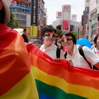 Participants smile as they march with a banner during the Tokyo Rainbow Pride parade celebrating the lesbian, gay, bisexual, and transgender (LGBT) community in Tokyo's Shibuya district, Sunday, May 7, 2017.