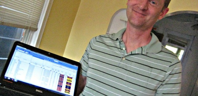 Math teacher Michael Colwell, at home with school utilization spreadsheets.