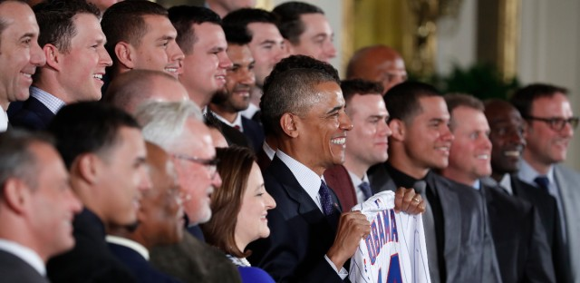 President Barack Obamas holds up a personalized Chicago Cubs baseball jersey
