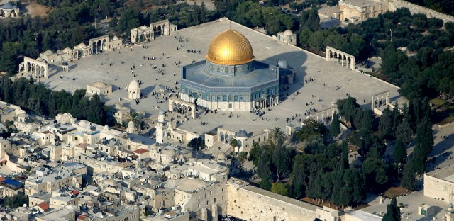 "In this aerial photo from files dated Oct. 20, 2005, Muslim worshippers gather outside the Dome of the Rock Mosque, in the Al Aqsa Mosque compound, also known to Jews as the Temple Mount, and Jews gather at the Western Wall, bottom center, the holiest site where Jews can pray, in Jerusalem's Old City. Conventional wisdom on Israeli-Palestinian peacemaking has long held that Israel should relinquish most of the lands it occupied in 1967 in favor of a Palestinian state, the ""two-state solution"" that much of the world has supported for years, but Mohammed Ishtayeh, a senior adviser to Palestinian President Mahmoud Abbas, said on Sunday Dec. 12, 2010 ""If Israel continues with these measures that it is employing today the possibility of a two-state solution becomes very slim."""