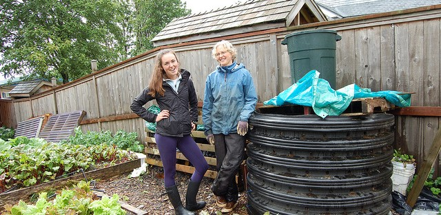 Sitka Local Foods Network intern Christine Devlin and lead gardener Laura Schmidt with compost