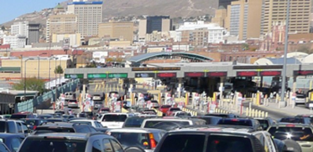 Cars and trucks wait in a two-hour line to reach the U.S. checkpoint on Paso del Norte, one of four bridges linking El Paso, Texas, to Ciudad Juárez, Chihuahua. Millions of vehicles enter the United States on those bridges each year, making it difficult for authorities to find hidden narcotics.
