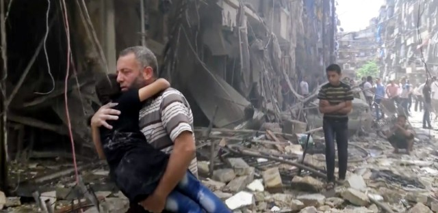 In this image made from video and posted online from Validated UGC, a man carries a child after airstrikes hit Aleppo, Syria, Thursday, April 28, 2016. A Syrian monitoring group and a first-responders team say new airstrikes on the rebel-held part of the contested city of Aleppo have killed over a dozen people and brought down at least one residential building. The new violence on Thursday brings the death toll in the past 24-hours in the deeply divided city to at least 61 killed.