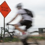 Lakefront Bicycler Speeding Past Sign