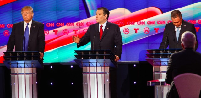 Republican presidential candidate, Sen. Ted Cruz, R-Texas, center, speaks during the Republican Presidential Primary Debate, as Republican presidential candidates, businessman Donald Trump, left, and Ohio Gov. John Kasich, right, listen onstage at the University of Houston Thursday, Feb. 25, 2016.
