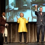 "In this April 9, 2016 file photo, Leslie Odum Jr., left, from the Broadway musical ""Hamilton,"" presidential candidate Hillary Clinton, center, and New York City Mayor Bill de Blasio, right, perform at the 94th annual Inner Circle Dinner in New York. Clinton and de Blasio have come under fire over their comedy skit at the show that some people feel was racially insensitive. Many in the room where it happened, which was filled with New York politicians, power brokers and reporters, laughed at the joke. But it soon made its way around social media and drew some scornful media coverage."