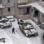 A Ukrainian serviceman walks past Ukrainian tanks in Avdiivka, eastern Ukraine, Thursday, Feb. 2, 2017. Two Ukrainian soldiers have been killed in the country's industrial east as both government forces and rebels reported shelling on their positions overnight, Ukraine's government said early Thursday. (AP Photo/Evgeniy Maloletka)