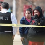 Police investigate the scene of a double homicide in Chicago