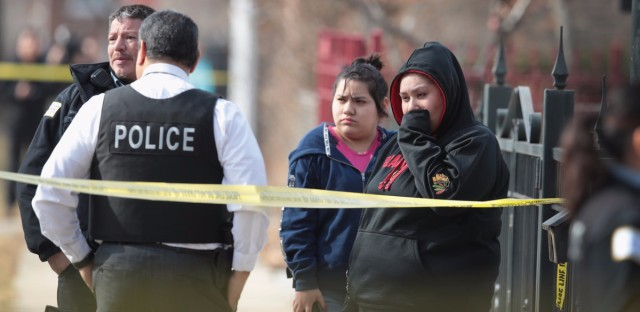 Police investigate the scene of a double homicide in Chicago