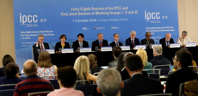 Intergovernmental Panel on Climate Change, IPCC, Chair Hoesung Lee, top center, and other leaders hold a press conference in Incheon, South Korea, Monday, Oct. 8, 2018. Preventing an extra single degree of heat could make a life-or-death difference in the next few decades for multitudes of people and ecosystems on this fast-warming planet, an international panel of scientists reported Sunday. But they provide little hope the world will rise to the challenge.