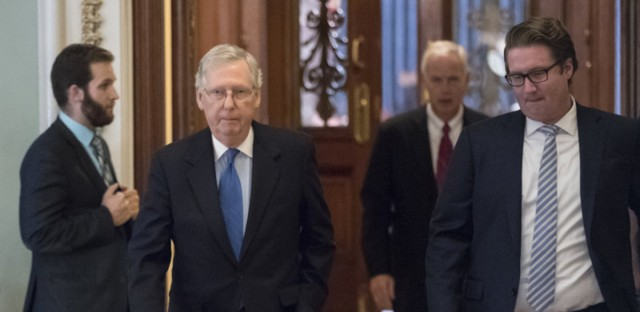 Senate Majority Leader Mitch McConnell, R-Ky., walks from the chamber to his office during a long series of votes at the Capitol on Thursday.