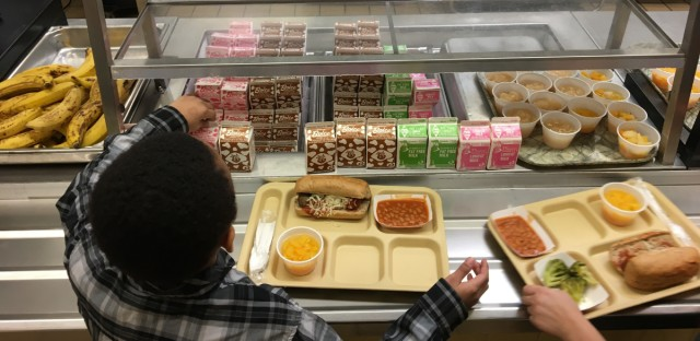 Students fill their lunch trays at a New York elementary school in 2017. A lawsuit in Manhattan federal court filed by six states, including Illinois, and D.C. asked a judge to overturn last year's changes to school nutritional standards, saying they were carried out in an arbitrary and capricious manner.
