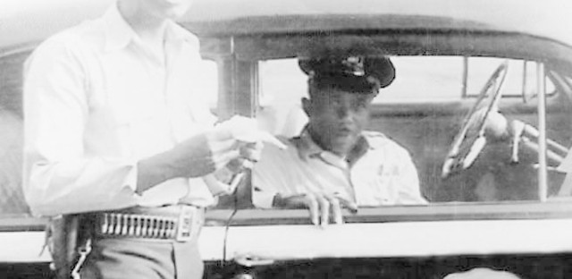 When officers Clarence White Sr. (left) and Albert Finnell joined the Indianapolis Police Department in the 1950s, they had to ride in either Car 27, or Car 29, which told the public African-American officers were in those cars.