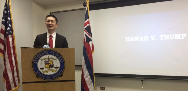 Hawaii Attorney General Doug Chin speaks at a news conference in Honolulu last month. On Tuesday, Chin filed a motion against Trump's revised ban.