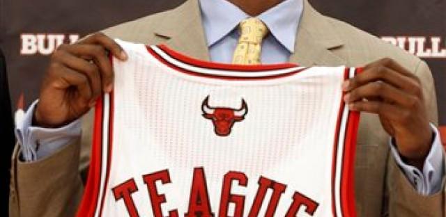 Marquis Teague displays his new Bulls jersey.