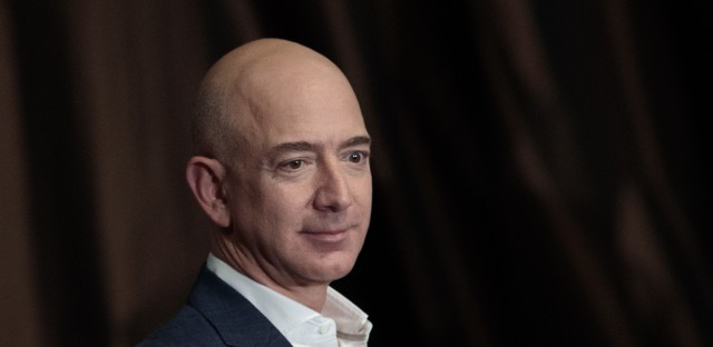 Jeff Bezos, chairman and founder of Amazon.com and owner of<em> The Washington Post</em>, addresses the Economic Club of New York in 2016. Bezos was briefly the richest person on earth, after Amazon stock values surged Thursday morning.