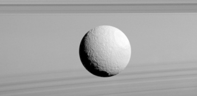The moon Tethys appears to float among the rings in an image returned to Earth on Feb. 8, 2016.
