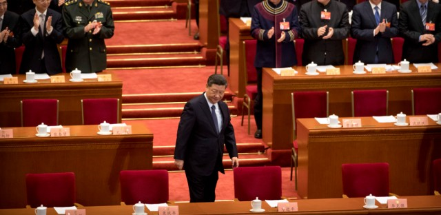 Chinese President Xi Jinping arrives for the closing session of the Chinese People's Political Consultative Conference (CPPCC) at the Great Hall of the People in Beijing, Wednesday, March 13, 2019.