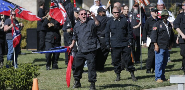 "In this Saturday, April 23, 2016 photo, members of the Ku Klux Klan participate in a ""white pride"" rally in Rome, Ga. Klan leaders say they feel that U.S. politics are going their way, as a nationalist, us-against-them mentality deepens across the nation. (AP Photo/John Bazemore)"