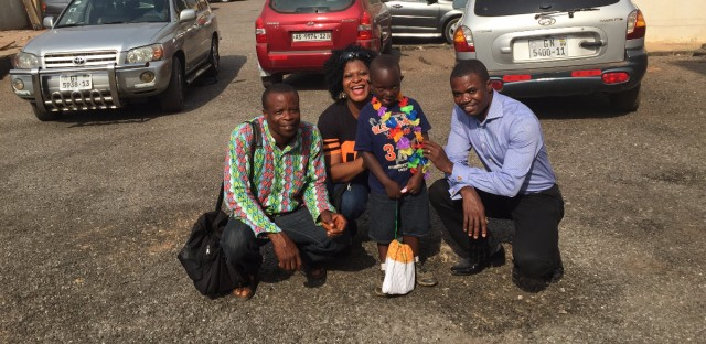Kodjo, who's 4, was born with a cleft and doomed to be drowned — until Dr. Solomon Obiri-Yeboah, in the blue shirt, performed surgery to correct the birth defect. Also in the photo: Kodjo's guardian (in the bright patterned shirt) and Nkeiruka Obi, West African regional director of Smile Train.